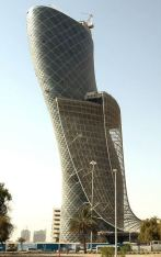 "A view of the 160-metre Capital Gate tower, developed by the Abu Dhabi National Exhibition Company, leans at 18 degrees -- over four times the angle of Italy's famous Leaning Tower of Pisa, has been recognised as the ""furthest-leaning man-made tower"" in the world by Guinness World Records, local newspapers reported on June 6, 2010. AFP PHOTO/STR (Photo credit should read STR/AFP/Getty Images)(Photo Credit should Read /AFP/Getty Images)"